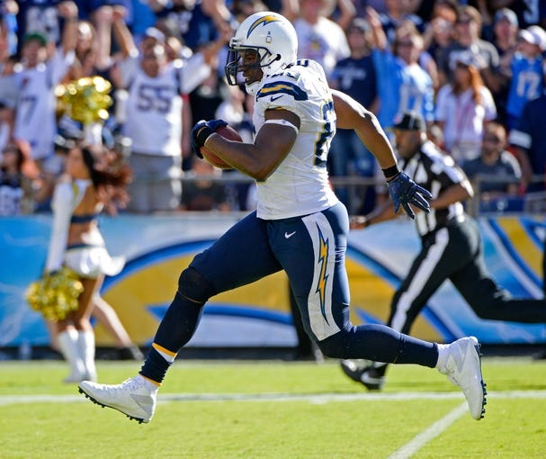 Sep 29, 2013; San Diego, CA, USA; San Diego Chargers tight end Antonio Gates (85) sprints to the end zone scoring a touchdown on a 56-yard pass play from quarterback Philip Rivers (not pictured) during second half action against the Dallas Cowboys at Qualcomm Stadium. Mandatory Credit: Robert Hanashiro-USA TODAY Sports