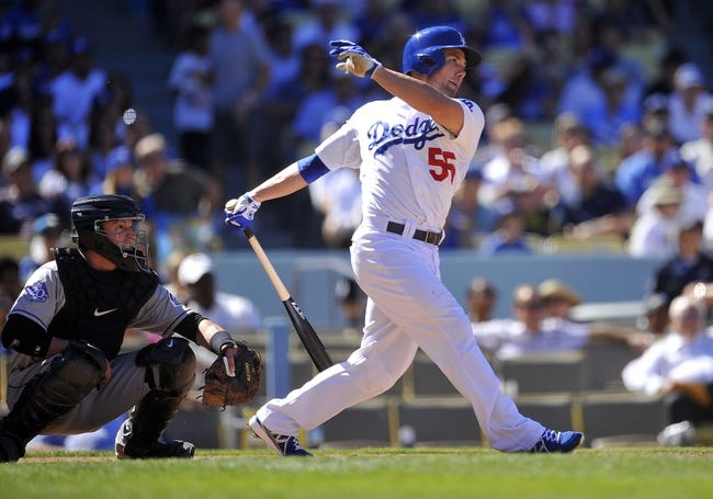 September 29, 2013; Los Angeles, CA, USA; Los Angeles Dodgers second baseman Skip Schumaker (55) hits an RBI single in the fifth inning against the Colorado Rockies at Dodger Stadium. Mandatory Credit: Gary A. Vasquez-USA TODAY Sports