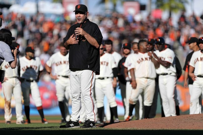 Sep 29, 2013; San Francisco, CA, USA; San Francisco Giants manager Bruce Bochy (15) thanks the fans after the final game of the season at AT&T Park. The San Francisco Giants defeated the San Diego Padres 7-6 with a walk-off win. Mandatory Credit: Kelley L Cox-USA TODAY Sports