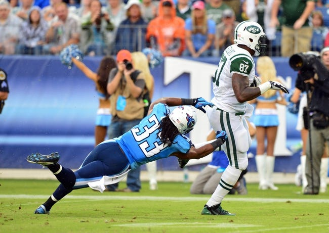 Sep 29, 2013; Nashville, TN, USA; New York Jets tight end Jeff Cumberland (87) breaks a tackle attempt by Tennessee Titans safety Michael Griffin (33) on his way to a touchdown during the second half at LP Field. The Titans beat the Jets 38-13. Mandatory Credit: Don McPeak-USA TODAY Sports