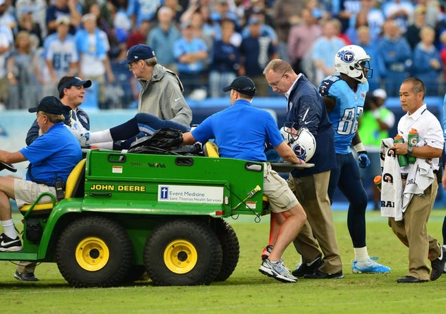 Sep 29, 2013; Nashville, TN, USA; Tennessee Titans quarterback Jake Locker (10) is carried off the field on a stretcher in a game against the New York Jets during the second half at LP Field. The Titans beat the Jets 38-13. Mandatory Credit: Don McPeak-USA TODAY Sports