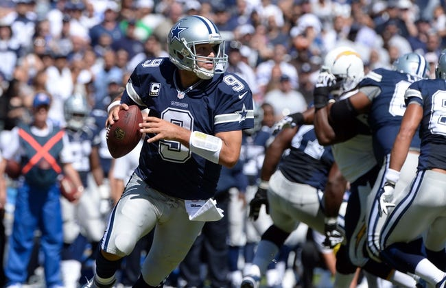Sep 29, 2013; San Diego, CA, USA; Dallas Cowboys quarterback Tony Romo (9) rolls out as he looks for an open receiver during first quarter action against the San Diego Chargers at Qualcomm Stadium.  Mandatory Credit: Robert Hanashiro-USA TODAY Sports