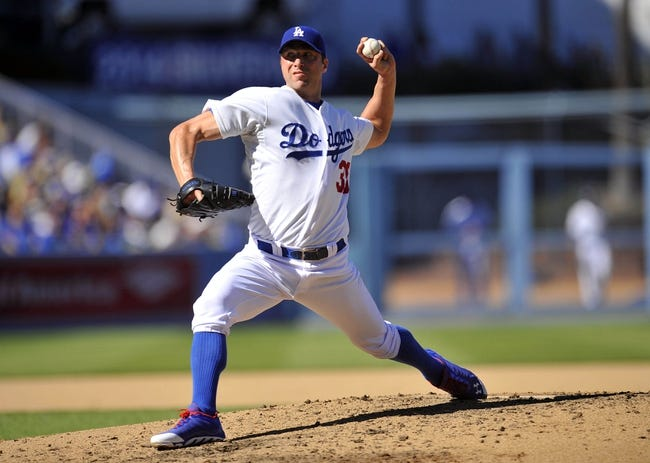 September 29, 2013; Los Angeles, CA, USA; Los Angeles Dodgers starting pitcher Chris Capuano (35) pitches during the sixth inning against the Colorado Rockies at Dodger Stadium. Mandatory Credit: Gary A. Vasquez-USA TODAY Sportsz