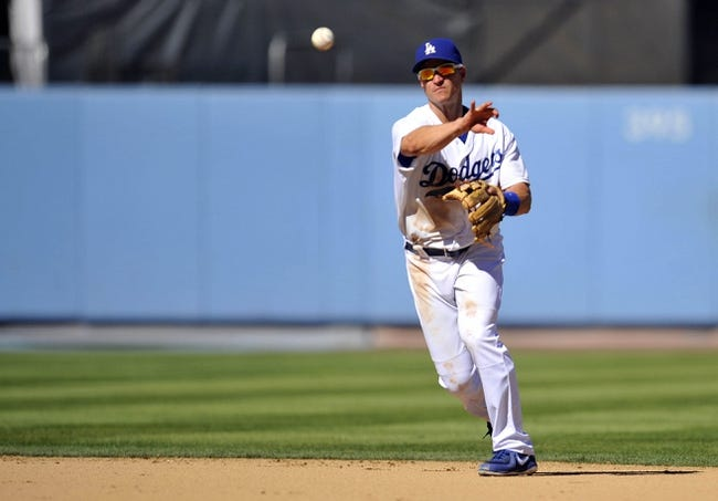 September 29, 2013; Los Angeles, CA, USA; Los Angeles Dodgers second baseman Mark Ellis (14) throws to first to complete an out in the sixth inning against the Colorado Rockies at Dodger Stadium. Mandatory Credit: Gary A. Vasquez-USA TODAY Sports