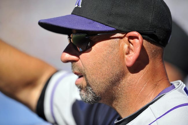 September 29, 2013; Los Angeles, CA, USA; Colorado Rockies manager Walt Weiss (22) watches game action during the sixth inning against the Los Angeles Dodgers at Dodger Stadium. Mandatory Credit: Gary A. Vasquez-USA TODAY Sports