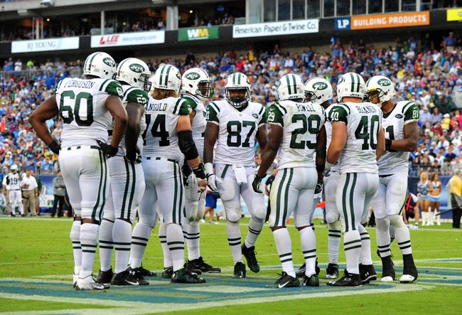 Sep 29, 2013; Nashville, TN, USA; The New York Jets offensive squad huddles in a game against the Tennessee Titans during the second half at LP Field. The Titans beat the Jets 38-13. Mandatory Credit: Don McPeak-USA TODAY Sports