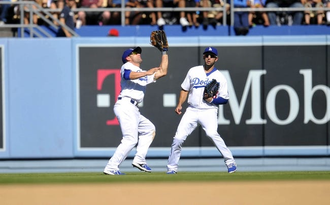 September 29, 2013; Los Angeles, CA, USA; Los Angeles Dodgers second baseman Skip Schumaker (55) catches a fly ball in the seventh inning against the Colorado Rockies at Dodger Stadium. Mandatory Credit: Gary A. Vasquez-USA TODAY Sports