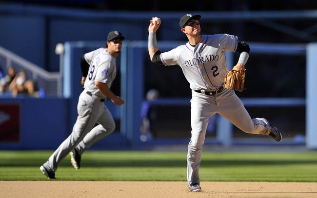 September 29, 2013; Los Angeles, CA, USA; Colorado Rockies shortstop Troy Tulowitzki (2) throws to first to complete an out in the eighth inning against the Los Angeles Dodgers at Dodger Stadium. Mandatory Credit: Gary A. Vasquez-USA TODAY Sports