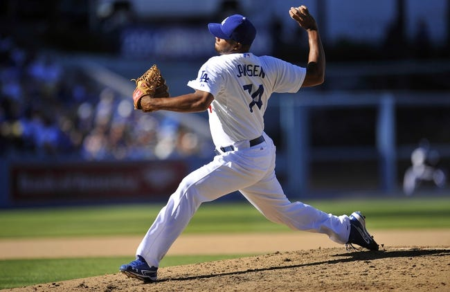 September 29, 2013; Los Angeles, CA, USA; Los Angeles Dodgers relief pitcher Kenley Jansen (74) pitches during the ninth inning against the Colorado Rockies at Dodger Stadium. Mandatory Credit: Gary A. Vasquez-USA TODAY Sports