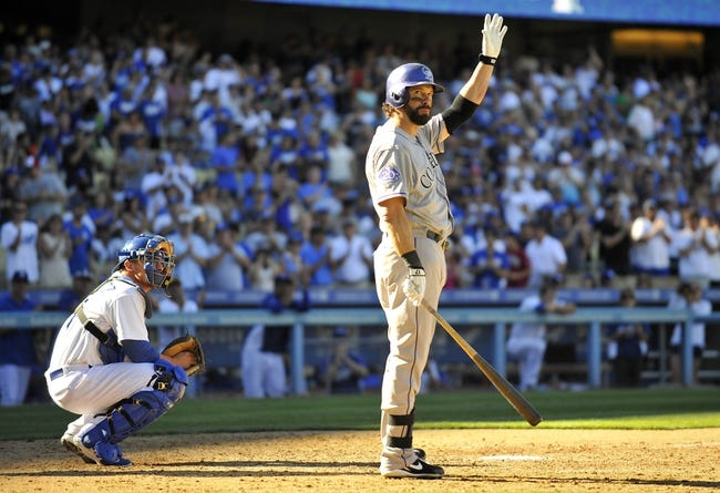 September 29, 2013; Los Angeles, CA, USA; Colorado Rockies first baseman Todd Helton (17) acknowledges the crowd before his final at bat of the game in the ninth inning against the Los Angeles Dodgers at Dodger Stadium. Mandatory Credit: Gary A. Vasquez-USA TODAY Sports