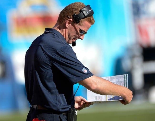 Sep 29, 2013; San Diego, CA, USA;  Dallas Cowboys head coach Jason Garrett  checks his play chart during the second half against the San Diego Chargers at Qualcomm Stadium. Mandatory Credit: Robert Hanashiro-USA TODAY Sports