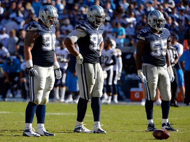 Sep 29, 2013; San Diego, CA, USA;  Dallas Cowboys defensive tackle Nick Hayden (96),  defensive tackle Jason Hatcher (97) and defensive end Edgar Jones (55) during the second half against the San Diego Chargers at Qualcomm Stadium. Mandatory Credit: Robert Hanashiro-USA TODAY Sports