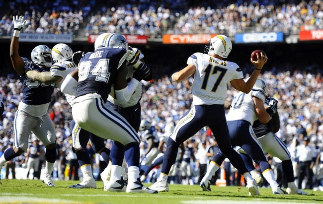 Sep 29, 2013; San Diego, CA, USA; San Diego Chargers quarterback Philip Rivers (17) throws under pressure during the second half against the Dallas Cowboys at Qualcomm Stadium. Mandatory Credit: Christopher Hanewinckel-USA TODAY Sports
