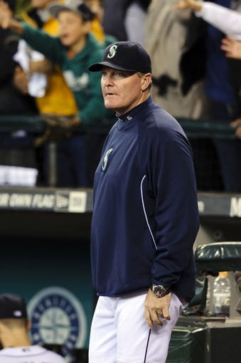 Sep 29, 2013; Seattle, WA, USA; Seattle Mariners manager Eric Wedge (22) after the game between the Seattle Mariners and the Oakland Athletics at Safeco Field. Oakland defeated Seattle 9-0. Mandatory Credit: Steven Bisig-USA TODAY Sports
