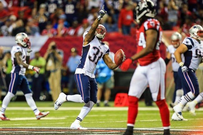 Sep 29, 2013; Atlanta, GA, USA; New England Patriots cornerback Aqib Talib (31) celebrates an interception in the second half against the New Atlanta Falcons at the Georgia Dome. The Patriots won 30-23. Mandatory Credit: Daniel Shirey-USA TODAY Sports