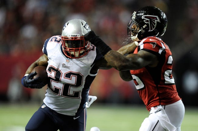 Sep 29, 2013; Atlanta, GA, USA; New England Patriots running back Stevan Ridley (22) straight arms Atlanta Falcons safety William Moore (25) during the second half at Georgia Dome. The Patriots defeated the Falcons 30-23. Mandatory Credit: Dale Zanine-USA TODAY Sports