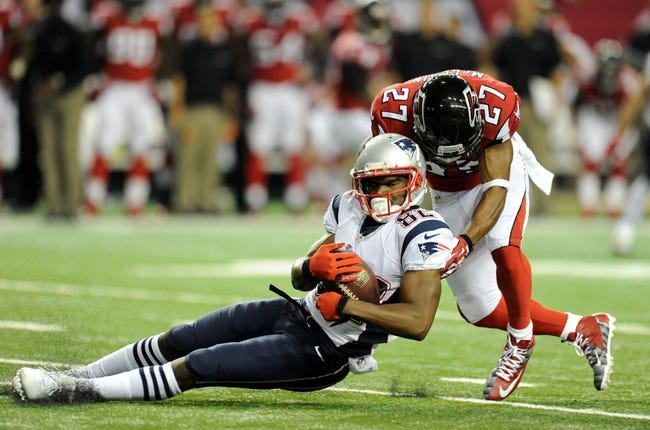 Sep 29, 2013; Atlanta, GA, USA; New England Patriots wide receiver Josh Boyce (82) makes a catch in front of Atlanta Falcons cornerback Robert McClain (27) during the second half at Georgia Dome. The Patriots defeated the Falcons 30-23. Mandatory Credit: Dale Zanine-USA TODAY Sports