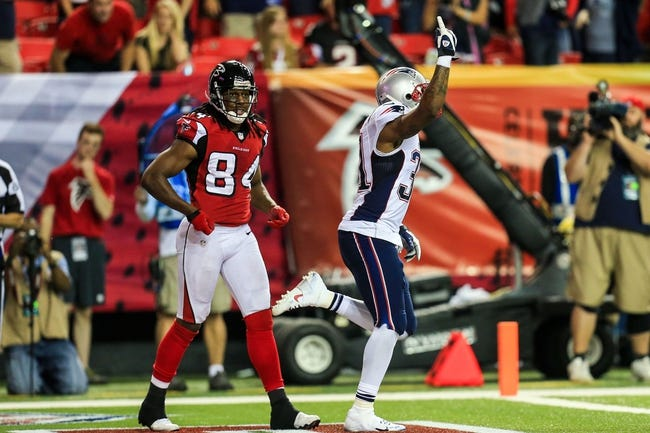 Sep 29, 2013; Atlanta, GA, USA; New England Patriots cornerback Aqib Talib (31) celebrates a pass break up in the end zone intended for Atlanta Falcons wide receiver Roddy White (84) in the final seconds in the fourth quarter at the Georgia Dome. The Patriots won 30-23. Mandatory Credit: Daniel Shirey-USA TODAY Sports