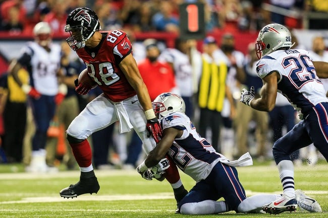 Sep 29, 2013; Atlanta, GA, USA; Atlanta Falcons tight end Tony Gonzalez (88) is tackled by New England Patriots defensive back Devin McCourty (32) after a catch in the second half at the Georgia Dome. The Patriots won 30-23. Mandatory Credit: Daniel Shirey-USA TODAY Sports