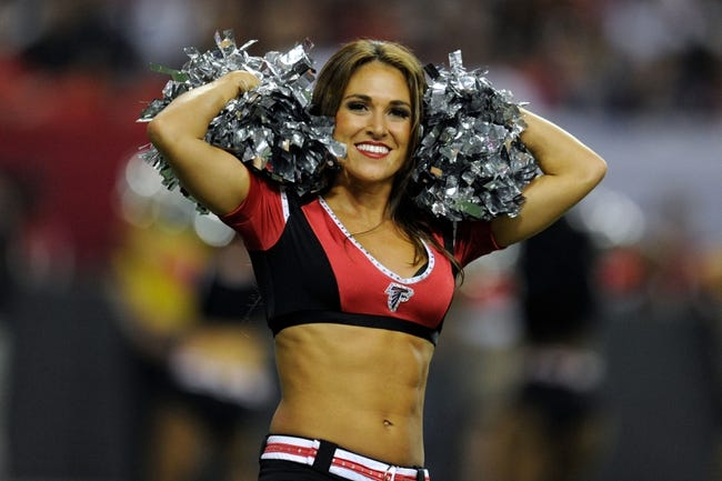 Sep 29, 2013; Atlanta, GA, USA; An Atlanta Falcons cheerleader performs during the gam against the New England Patriots during the second half at Georgia Dome. The Patriots defeated the Falcons 30-23. Mandatory Credit: Dale Zanine-USA TODAY Sports