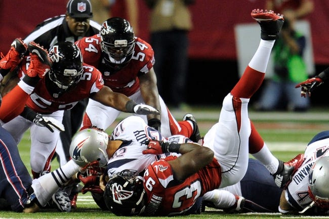 Sep 29, 2013; Atlanta, GA, USA; New England Patriots quarterback Tom Brady (12) recovers his own fumble on fourth down against the Atlanta Falcons during the second half at Georgia Dome. The Patriots defeated the Falcons 30-23. Mandatory Credit: Dale Zanine-USA TODAY Sports
