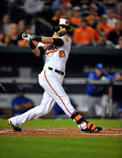 Sep 25, 2013; Baltimore, MD, USA; Baltimore Orioles right fielder Nick Markakis (21) bats in the first inning against the Toronto Blue Jays at Oriole Park at Camden Yards. The Orioles defeated the Blue Jays 9-5. Mandatory Credit: Joy R. Absalon-USA TODAY Sports