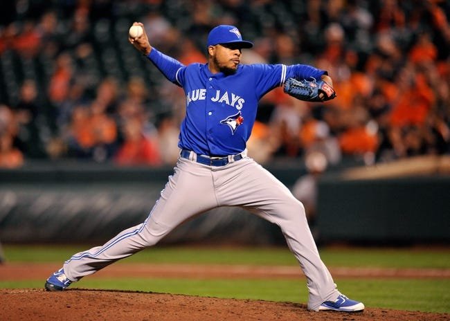 Sep 25, 2013; Baltimore, MD, USA; Toronto Blue Jays pitcher Jermey Jeffress (33) throws in the sixth inning against the Baltimore Orioles at Oriole Park at Camden Yards. The Orioles defeated the Blue Jays 9-5. Mandatory Credit: Joy R. Absalon-USA TODAY Sports