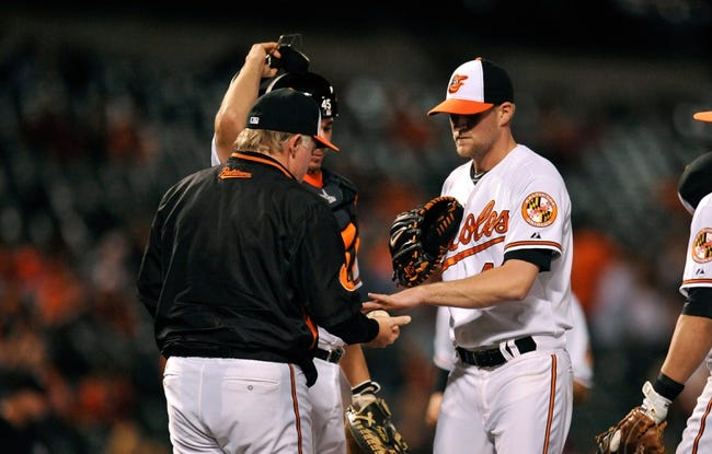 Sep 25, 2013; Baltimore, MD, USA; Baltimore Orioles manager Buck Showalter (26) takes the ball from reliever Troy Patton (40) in the seventh inning against the Toronto Blue Jays at Oriole Park at Camden Yards. The Orioles defeated the Blue Jays 9-5. Mandatory Credit: Joy R. Absalon-USA TODAY Sports