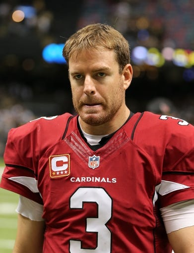 Sep 22, 2013; New Orleans, LA, USA; Arizona Cardinals quarterback Carson Palmer (3) walks off the field at the conclusion of their game against the New Orleans Saints at Mercedes-Benz Superdome. Mandatory Credit: Chuck Cook-USA TODAY Sports