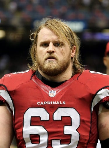 Sep 22, 2013; New Orleans, LA, USA; Arizona Cardinals center Lyle Sendlein (63) walks off the field at the conclusion of their game against the New Orleans Saints at Mercedes-Benz Superdome. Mandatory Credit: Chuck Cook-USA TODAY Sports