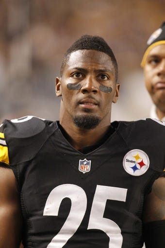 Sep 22, 2013; Pittsburgh, PA, USA; Pittsburgh Steelers free safety Ryan Clark (25) on the sidelines against the Chicago Bears during the third quarter at Heinz Field. The Bears won 40-23. Mandatory Credit: Charles LeClaire-USA TODAY Sports