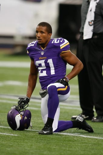 Aug 29, 2013; Minneapolis, MN, USA; Minnesota Vikings cornerback Josh Robinson (21) rests during drills before the game with the Tennessee Titans at Mall of America Field at H.H.H. Metrodome. Vikings win 24-23. Mandatory Credit: Bruce Kluckhohn-USA TODAY Sports