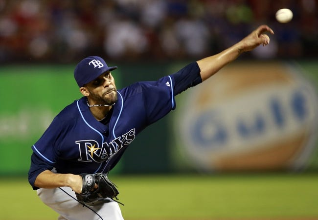 Sep 30, 2013; Arlington, TX, USA; Tampa Bay Rays starting pitcher David Price throws a pitch against the Texas Rangers during the fourth inning at Rangers Ballpark at Arlington. Mandatory Credit: Tim Heitman-USA TODAY Sports