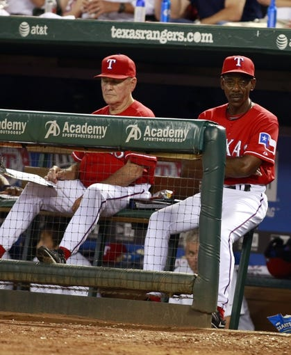 Sep 30, 2013; Arlington, TX, USA; Texas Rangers manager Ron Washington (right) during the seventh inning against the Tampa Bay Rays at Rangers Ballpark at Arlington. Mandatory Credit: Tim Heitman-USA TODAY Sports