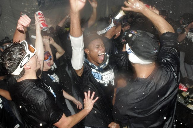 Sep 30, 2013; Arlington, TX, USA; Members of the Tampa Bay Rays celebrate in the clubhouse after defeating the Texas Rangers 5-2 at Rangers Ballpark at Arlington. Mandatory Credit: Tim Heitman-USA TODAY Sports