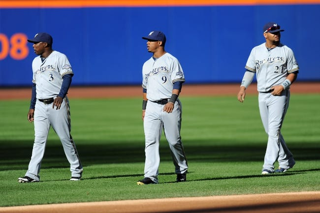 Sep 28, 2013; New York, NY, USA; Milwaukee Brewers first baseman Yuniesky Betancourt (3) and shortstop Jean Segura (9) and first baseman Juan Francisco (21) walk to the dugout before facing the New York Mets at Citi Field. The Brewers won the game 4-2. Mandatory Credit- Joe Camporeale-USA TODAY Sports