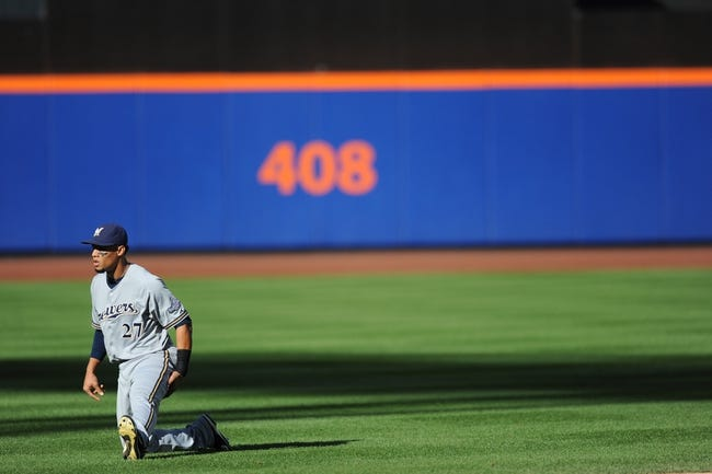 Sep 28, 2013; New York, NY, USA; Milwaukee Brewers center fielder Carlos Gomez (27) stretches before facing the New York Mets at Citi Field. The Brewers won the game 4-2. Mandatory Credit- Joe Camporeale-USA TODAY Sports