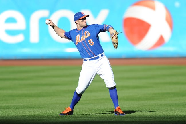 Sep 28, 2013; New York, NY, USA; New York Mets third baseman David Wright (5) warms up before facing the Milwaukee Brewers at Citi Field. The Brewers won the game 4-2. Mandatory Credit- Joe Camporeale-USA TODAY Sports