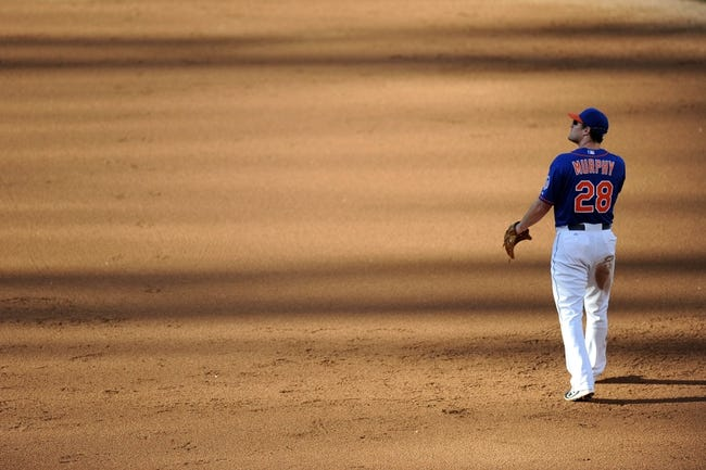 Sep 28, 2013; New York, NY, USA; New York Mets second baseman Daniel Murphy (28) looks on against the Milwaukee Brewers at Citi Field. The Brewers won the game 4-2. Mandatory Credit- Joe Camporeale-USA TODAY Sports