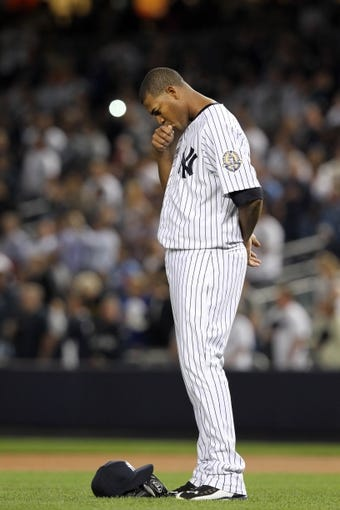 Sep 26, 2013; Bronx, NY, USA; New York Yankees starting pitcher Ivan Nova (47) before a game against the Tampa Bay Rays at Yankee Stadium. Mandatory Credit: Brad Penner-USA TODAY Sports