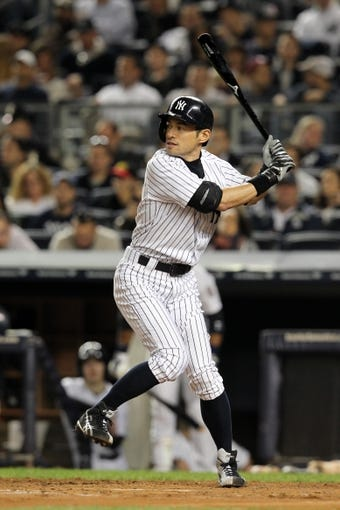 Sep 26, 2013; Bronx, NY, USA; New York Yankees right fielder Ichiro Suzuki (31) bats against the Tampa Bay Rays during a game at Yankee Stadium. Mandatory Credit: Brad Penner-USA TODAY Sports