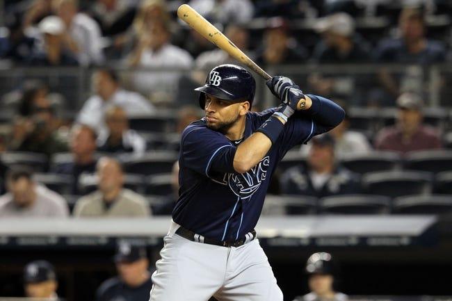 Sep 26, 2013; Bronx, NY, USA; Tampa Bay Rays first baseman James Loney (21) bats against the New York Yankees during a game at Yankee Stadium. Mandatory Credit: Brad Penner-USA TODAY Sports