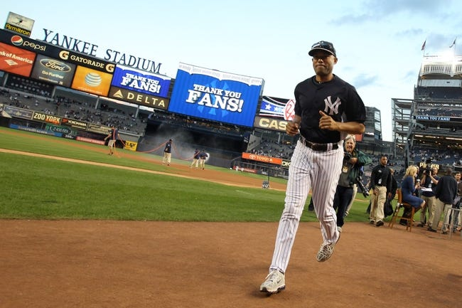 Sep 26, 2013; Bronx, NY, USA; New York Yankees relief pitcher Mariano Rivera (42) runs off the field before his final home game against the Tampa Bay Rays at Yankee Stadium. Mandatory Credit: Brad Penner-USA TODAY Sports