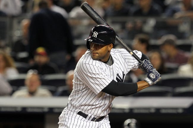 Sep 26, 2013; Bronx, NY, USA; New York Yankees left fielder Zoilo Almonte (63) bats against the Tampa Bay Rays during a game at Yankee Stadium. Mandatory Credit: Brad Penner-USA TODAY Sports