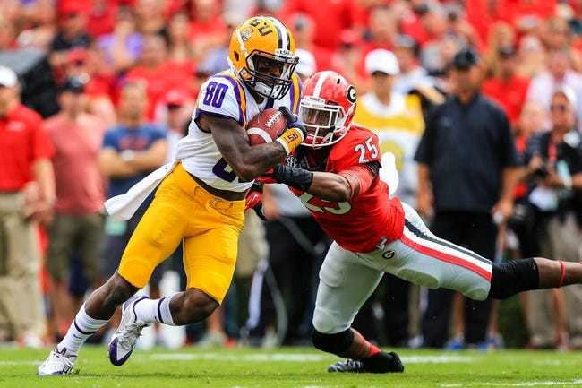 Sep 28, 2013; Athens, GA, USA; LSU Tigers wide receiver Jarvis Landry (80) runs past Georgia Bulldogs safety Josh Harvey-Clemons (25) for extra yards after a catch in the first half at Sanford Stadium. Georgia won 44-41. Mandatory Credit: Daniel Shirey-USA TODAY Sports