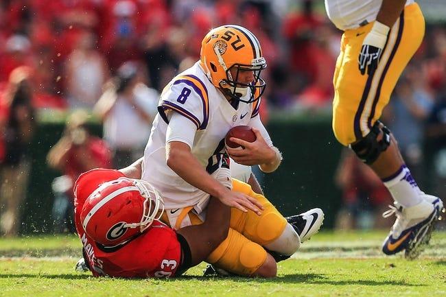 Sep 28, 2013; Athens, GA, USA; Georgia Bulldogs nose tackle Chris Mayes (93) sacks LSU Tigers quarterback Zach Mettenberger (8) in the first half at Sanford Stadium. Georgia won 44-41. Mandatory Credit: Daniel Shirey-USA TODAY Sports