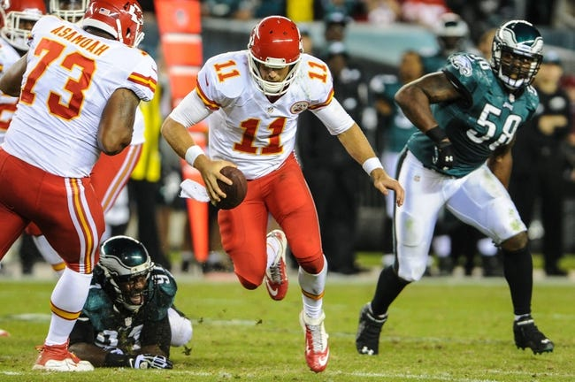 Sep 19, 2013; Philadelphia, PA, USA; Kansas City Chiefs quarterback Alex Smith (11) escapes an attempted tackle by Philadelphia Eagles defensive end Fletcher Cox (91) during the second quarter of the game at Lincoln Financial Field. Mandatory Credit: John Geliebter-USA TODAY Sports