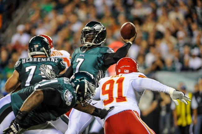 Sep 19, 2013; Philadelphia, PA, USA; Philadelphia Eagles quarterback Michael Vick (7) passes under pressure from Kansas City Chiefs outside linebacker Tamba Hali (91) during the first quarter of the game at Lincoln Financial Field. Mandatory Credit: John Geliebter-USA TODAY Sports