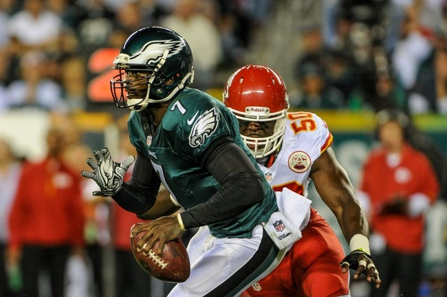 Sep 19, 2013; Philadelphia, PA, USA; Philadelphia Eagles quarterback Michael Vick (7) scrambles for a first down during the first quarter of the game against the Kansas City Chiefs at Lincoln Financial Field. Mandatory Credit: John Geliebter-USA TODAY Sports