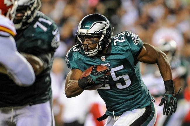 Sep 19, 2013; Philadelphia, PA, USA; Philadelphia Eagles running back LeSean McCoy (25) carries the ball during the third quarter of the game against the Kansas City Chiefs at Lincoln Financial Field. The Kansas City Chiefs beat the Philadelphia Eagles 26-16. Mandatory Credit: John Geliebter-USA TODAY Sports